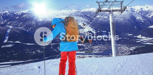 Composite image of full length of skier skiing on snow
