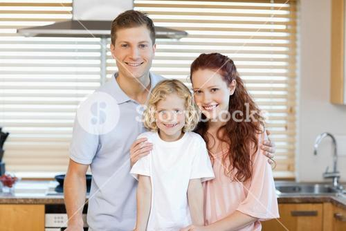 Family standing together in the kitchen