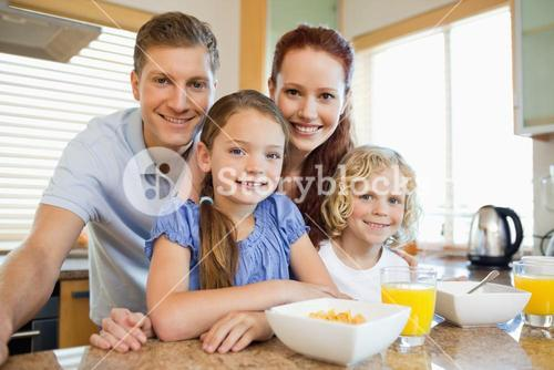 Family with breakfast in the kitchen