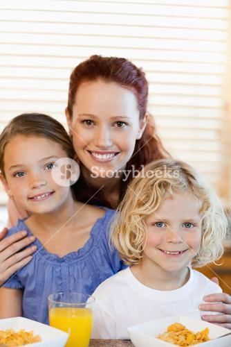 Mother with children and cereals in the kitchen