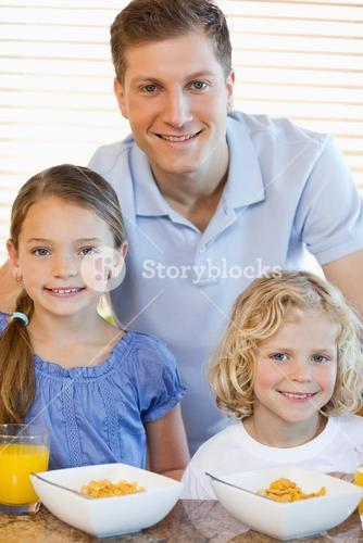 Father with his children and cereals