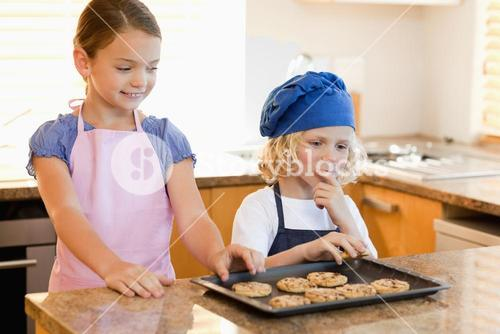 Siblings stealing cookies