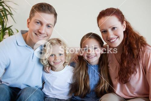 Family sitting on the sofa together