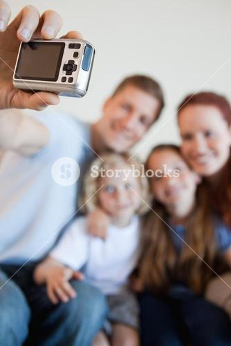 Digi cam being used to take family picture