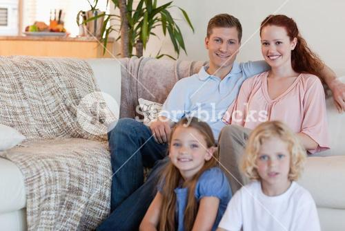 Family sitting in the living room