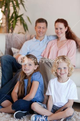 Happy family sitting in the living room