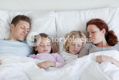 Family taking a nap together