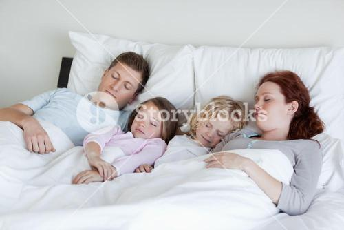 Adorable family snoozing together