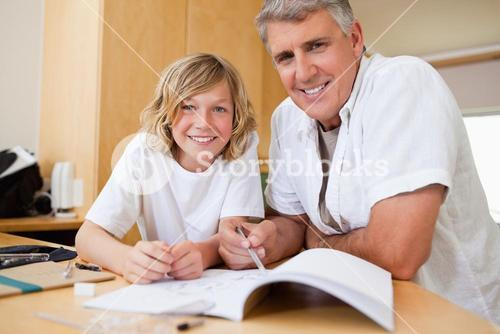 Father helping son with his homework
