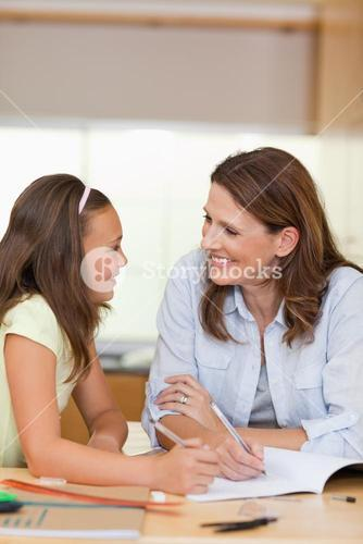 Woman doing homework with her daughter