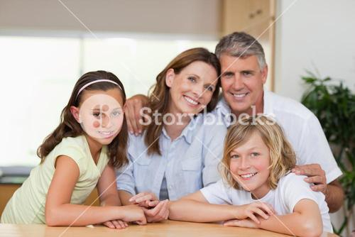 Family together behind table