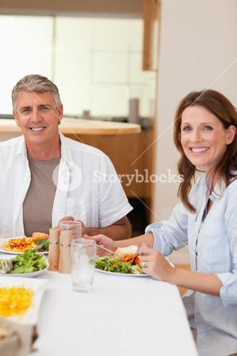 Happy couple eating dinner