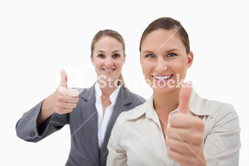 Sales persons posing with the thumb up