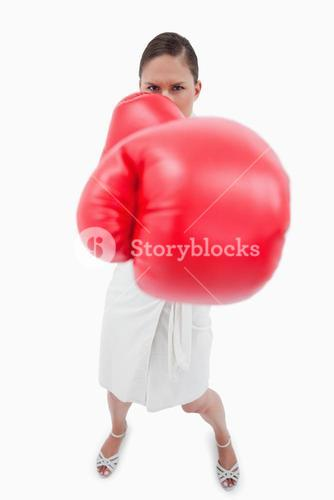 Portrait of an angry boxing businesswoman