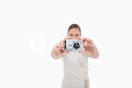 Young businesswoman taking a picture