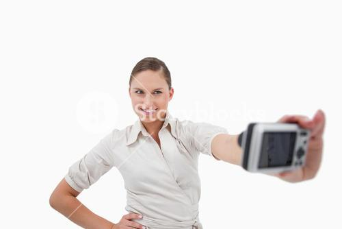 Young businesswoman taking a picture of herself