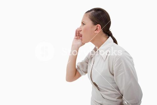 Side view of a businesswoman shouting