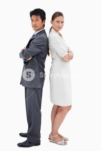 Portrait of business people standing back-to-back
