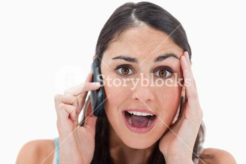 Shocked woman making a phone call