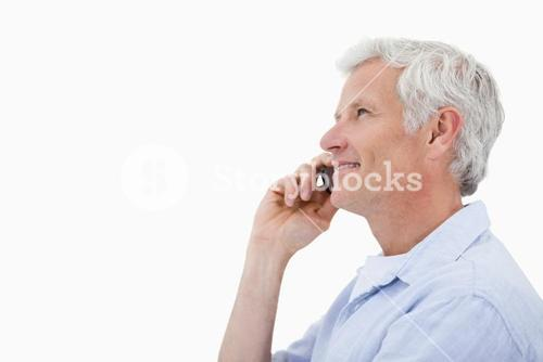 Side view of a mature man making a phone call