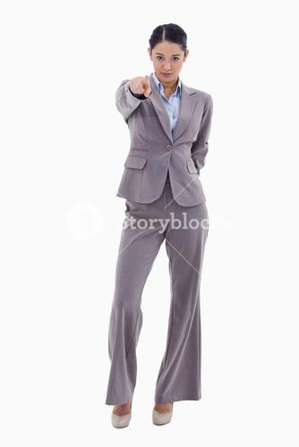 Portrait of a serious businesswoman pointing at the viewer