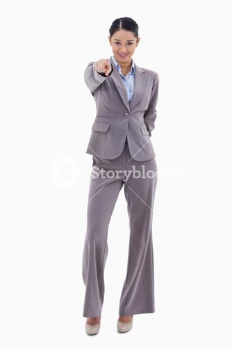 Portrait of a happy businesswoman pointing at the viewer