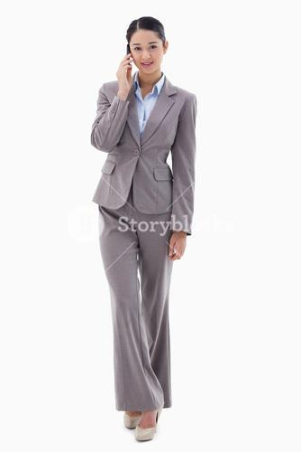 Portrait of a young businesswoman making a phone call