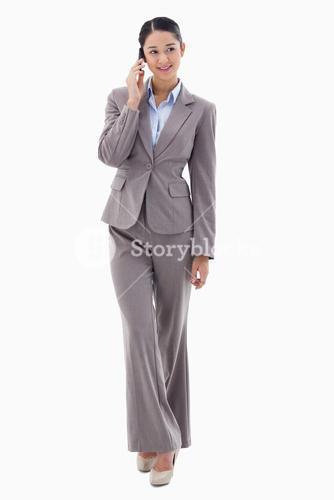Portrait of a brunette businesswoman making a phone call