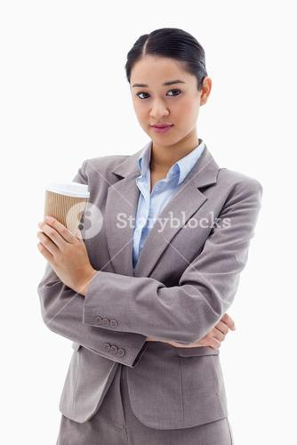 Portrait of a young businesswoman holding a takeaway tea