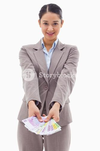 Portrait of a smiling businesswoman showing bank notes