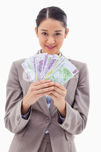 Portrait of a businesswoman holding bank notes