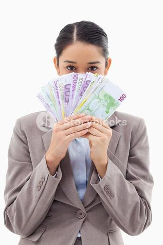 Portrait of a greedy businesswoman holding bank notes