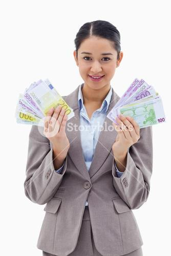 Portrait of a happy businesswoman holding bank notes