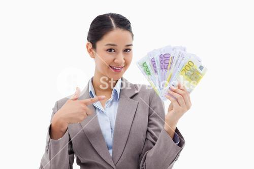 Smiling businesswoman holding bank notes