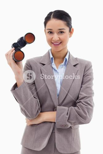 Portrait of a businesswoman holding binoculars