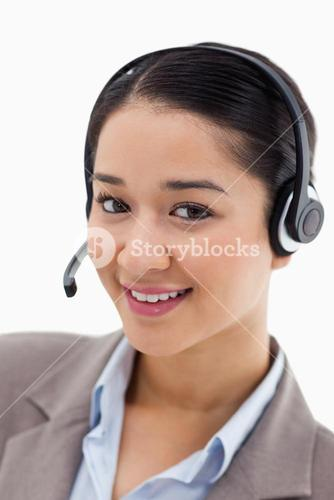 Portrait of a happy office worker posing with a headset