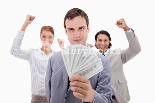 Successful businessman with cheering colleagues