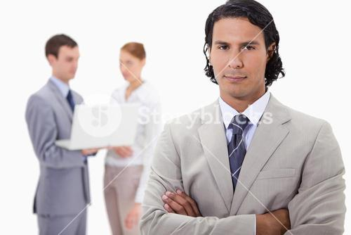 Businessman with colleagues working on laptop