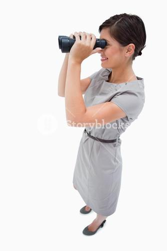 Side view of woman using spyglasses
