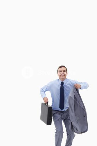 Happy businessman with suitcase about to jump