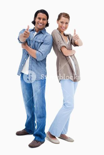 Smiling couple giving thumbs up