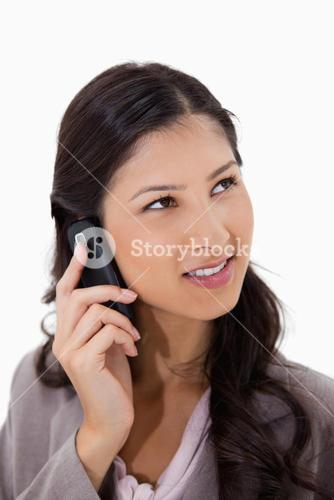 Woman listening to caller on the phone