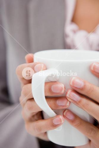 Cup being held by female hands