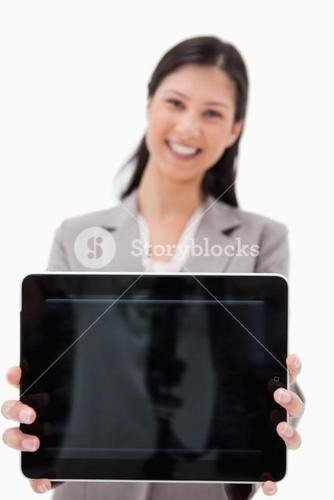 Smiling businesswoman presenting tablet screen