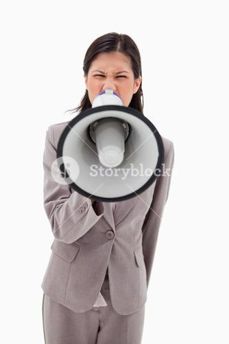 Angry businesswoman yelling through megaphone