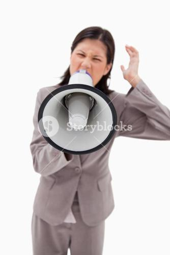 Angry businesswoman shouting through businesswoman