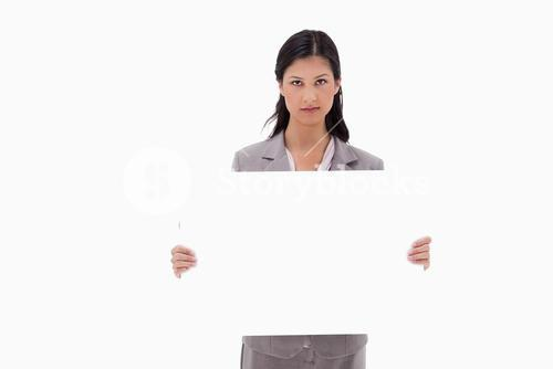 Businesswoman with blank sign board