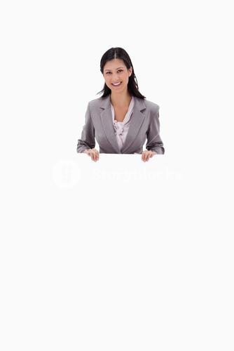 Businesswoman holding blank sign board