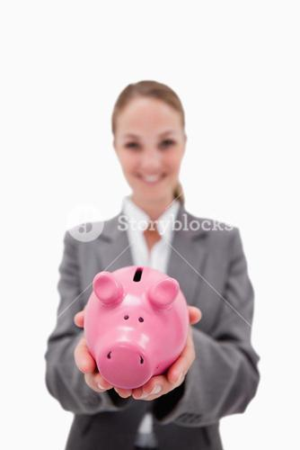 Piggy bank being held by smiling bank employee