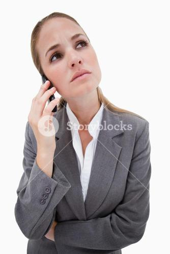 Sad bank employee on her cellphone